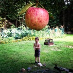 If I were this giant apple, I'd retaliate. I'd applesauce this kid. Squash.